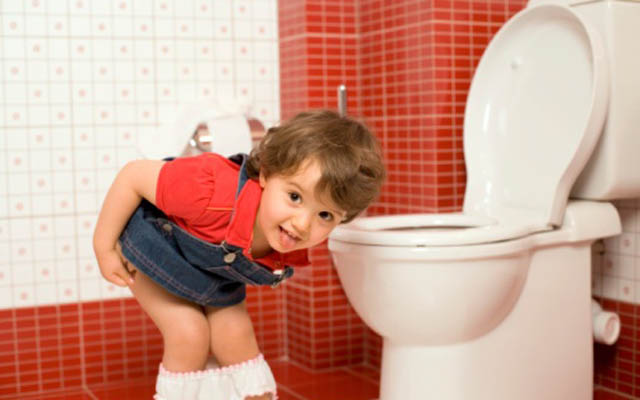 Girl using toilet